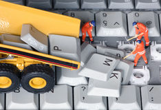 Keyboard 10. Small men repairing computer keyboard royalty free stock photos