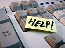 Keyboard. Help word on a post-it, on a keyboard Stock Photos