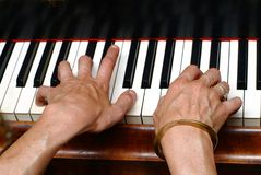 Keyboard. Two hands on piano keys Royalty Free Stock Photos