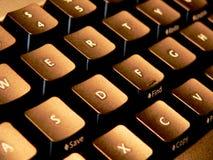 Keyboard. Sidelit computer keyboard closeup Stock Image