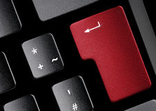 Keyboard. Black keyboard with a red key. Use it for technical concepts Royalty Free Stock Photo