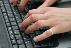 Keyboard. Female fingers on laptop keyboard Royalty Free Stock Images