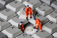 Keyboard. Small men repairing keyboard computer royalty free illustration