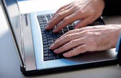 Keyboard. Hand on keyboard writing e-mail Royalty Free Stock Photos