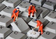 Keyboard 5. Small men repairing computer keyboard royalty free stock photos