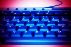 Keyboard. The dark blue keyboard on a red background stock images