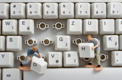 Keyboard. Close up of computer keyboard and toy workers Stock Image