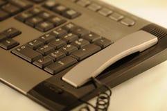 Keyboard. Slim keyboard and gray telephone Stock Photography