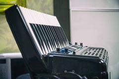 Keyboard accordion standing on the table royalty free stock image