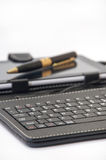 Keyboard for android in focus and the tablet  background Stock Photos