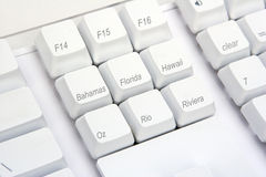 Keyboard Angle Beaches. Beach destinations on the keys of a computer keyboard Stock Photo