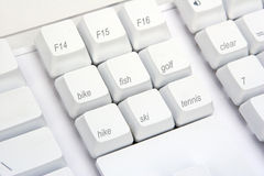 Keyboard Angle Sports. Sports activities are written on the keys of a keyboard Stock Photography
