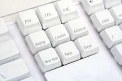 Keyboard Angle World. Names of world cities superimposed on a keyboard Royalty Free Stock Images