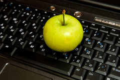 Keyboard and apple Royalty Free Stock Photography