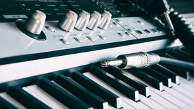 Keyboard with audio jacks shot with shallow depth of field. Royalty Free Stock Images