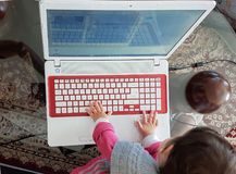 Keyboard baby laptop first steps red Royalty Free Stock Photography