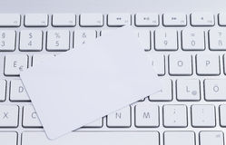 Keyboard with blank card. A white colored keyboard with a white blanc pastic card Royalty Free Stock Image