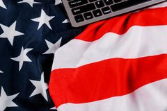 Keyboard with blank notepad with office table american flag. Keyboard with blank notepad with digital office american flag laptop pc table wooden work notebook royalty free stock images