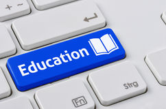 Keyboard with a blue button - Education Stock Images