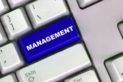 Keyboard with blue button of management stock images