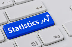 Keyboard with a blue button - Statistics Stock Photography