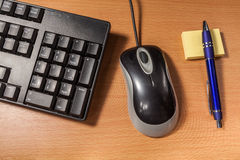 Keyboard blur. Black keyboard and mouse on the table whit blur Royalty Free Stock Images