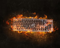 Keyboard burning with fire Stock Images
