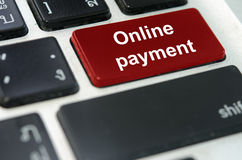Keyboard button Online payment. A keyboard with a red button Online payment royalty free stock photo