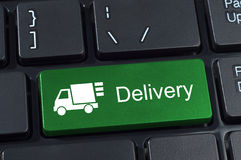 Keyboard button with truck icon and text delivery. Royalty Free Stock Images