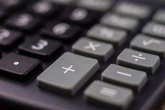 The keyboard of the calculator on a larger scale. Buttons with m. Athematical markings and numbers. Dark background royalty free stock photography