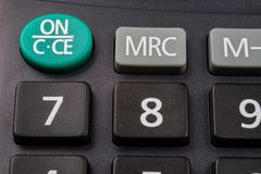 The keyboard of the calculator on a larger scale. Buttons with m. Athematical markings and numbers. Dark background stock photos