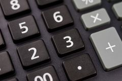 The keyboard of the calculator on a larger scale. Buttons with m. Athematical markings and numbers. Dark background royalty free stock images