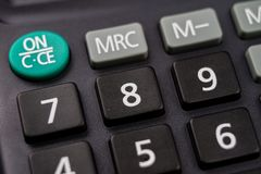 The keyboard of the calculator on a larger scale. Buttons with m. Athematical markings and numbers. Dark background stock photo