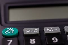 The keyboard of the calculator on a larger scale. Buttons with m. Athematical markings and numbers. Dark background stock photography