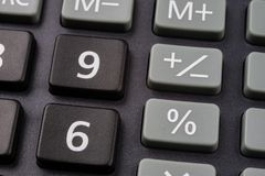 The keyboard of the calculator on a larger scale. Buttons with m. Athematical markings and numbers. Dark background stock image