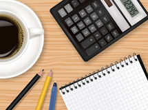 Keyboard, calculator and office supplies. Royalty Free Stock Photos