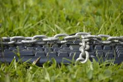 Keyboard chained on grass. Royalty Free Stock Photo