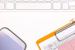 keyboard, chart, and smartphone royalty free stock photos