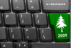 Keyboard with Christmas tree key Royalty Free Stock Photos
