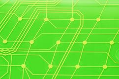 Keyboard circuit membrane. Green toned, close up stock images