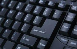 Keyboard Closeup. Closeup of Black Keyboard, Enter Key is in focus Stock Images