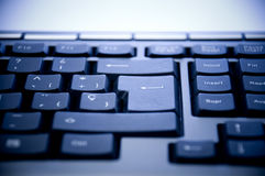Keyboard closeup. Over blue background Royalty Free Stock Photos