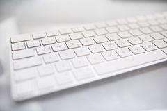 Keyboard closeup image on white table. Ready for writting royalty free stock photos