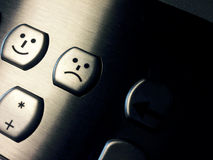 Keyboard closeup with smile and sad faces Stock Images