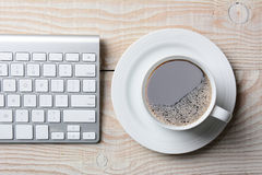 Keyboard and Coffee Royalty Free Stock Images