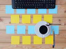 Keyboard, colored stickers cup of coffee and office supplies Stock Images