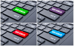 Keyboard with colorful web domain buttons stock photo
