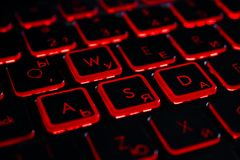 Keyboard. A computer keyboard glowing in red royalty free stock image