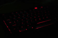 Keyboard. Computer keyboard with glowing red light at night Royalty Free Stock Image
