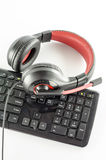 Keyboard computer and headphone. On a white background royalty free stock photo